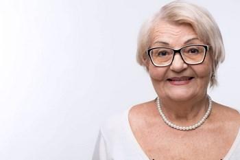 smiling older woman on eye disease ad
