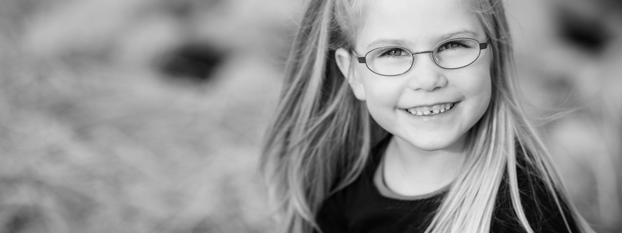 Young Girl Smiling Glasses 1280x480