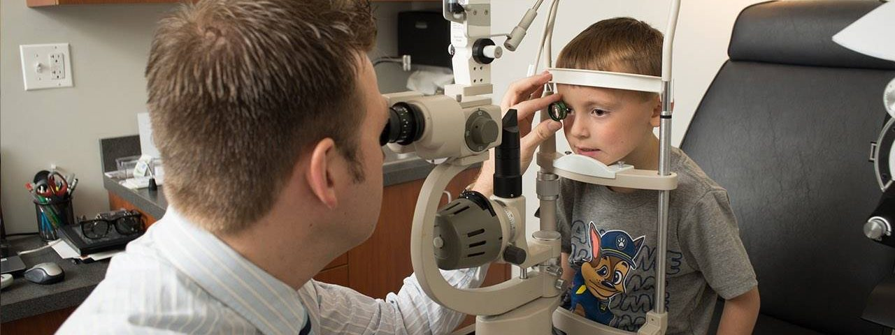 Eye doctor, boy receiving eye exam in Mentor, OH