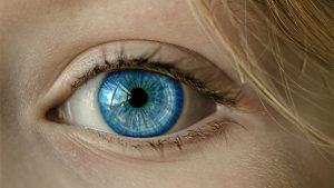 eye blue eye iris pupil face in Olathe, KS