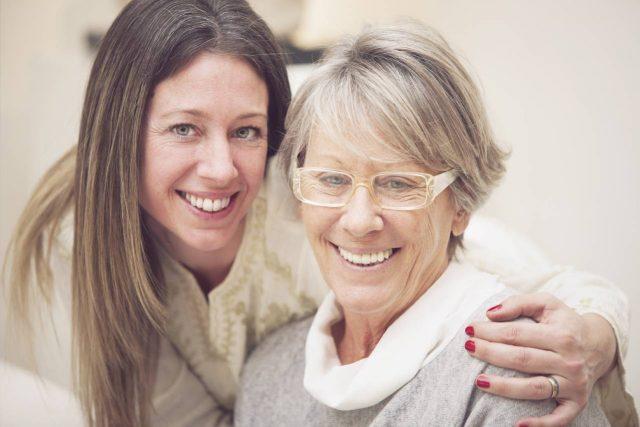 Eye doctor, senior woman smiling in Olathe, KS