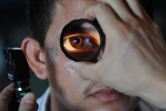 Eye doctor, man at an eye exam in Olathe, KS