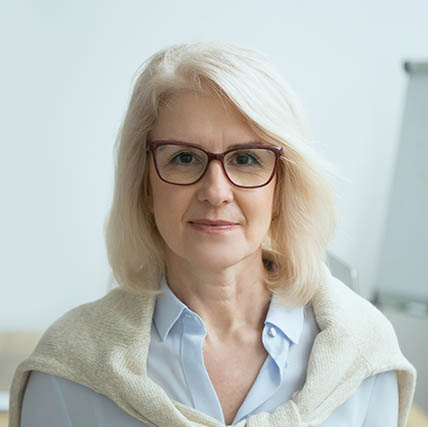 eye exam, Middle-Aged Woman Wearing Eyeglasses | Olathe