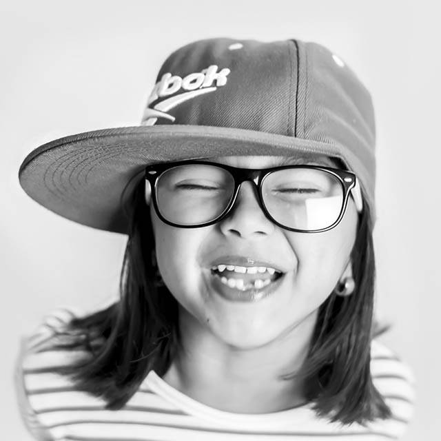 Young girl wearing eye glasses and smiling