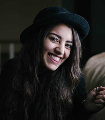 woman-wearing-black-hat-smile