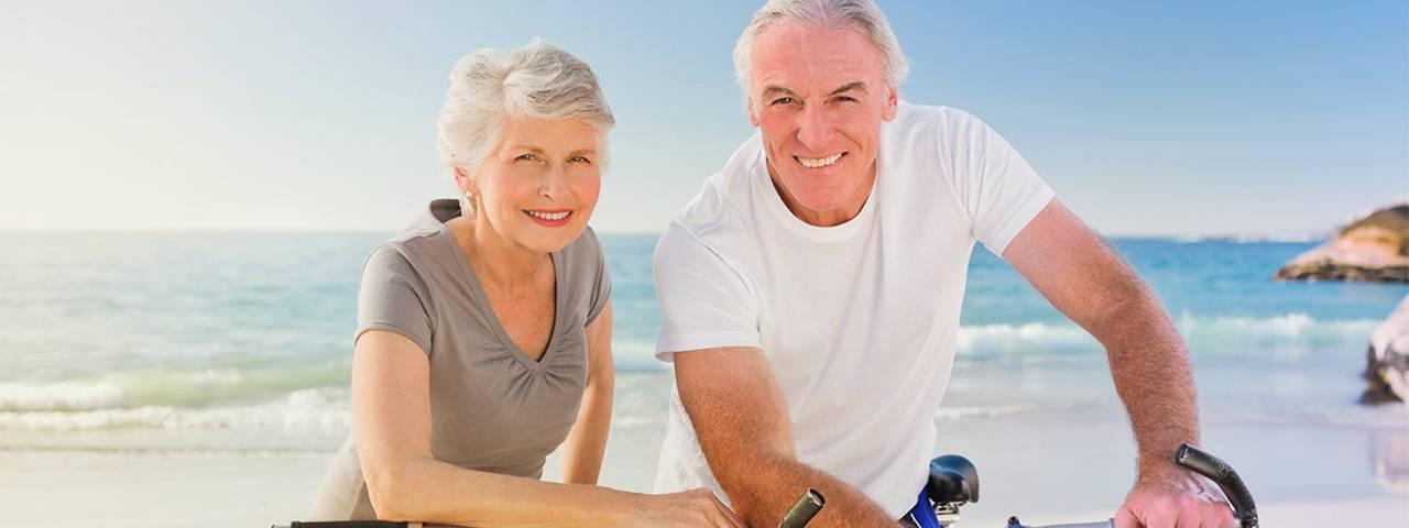 Senior couple on a beach, Optometrist in Totowa, NJ