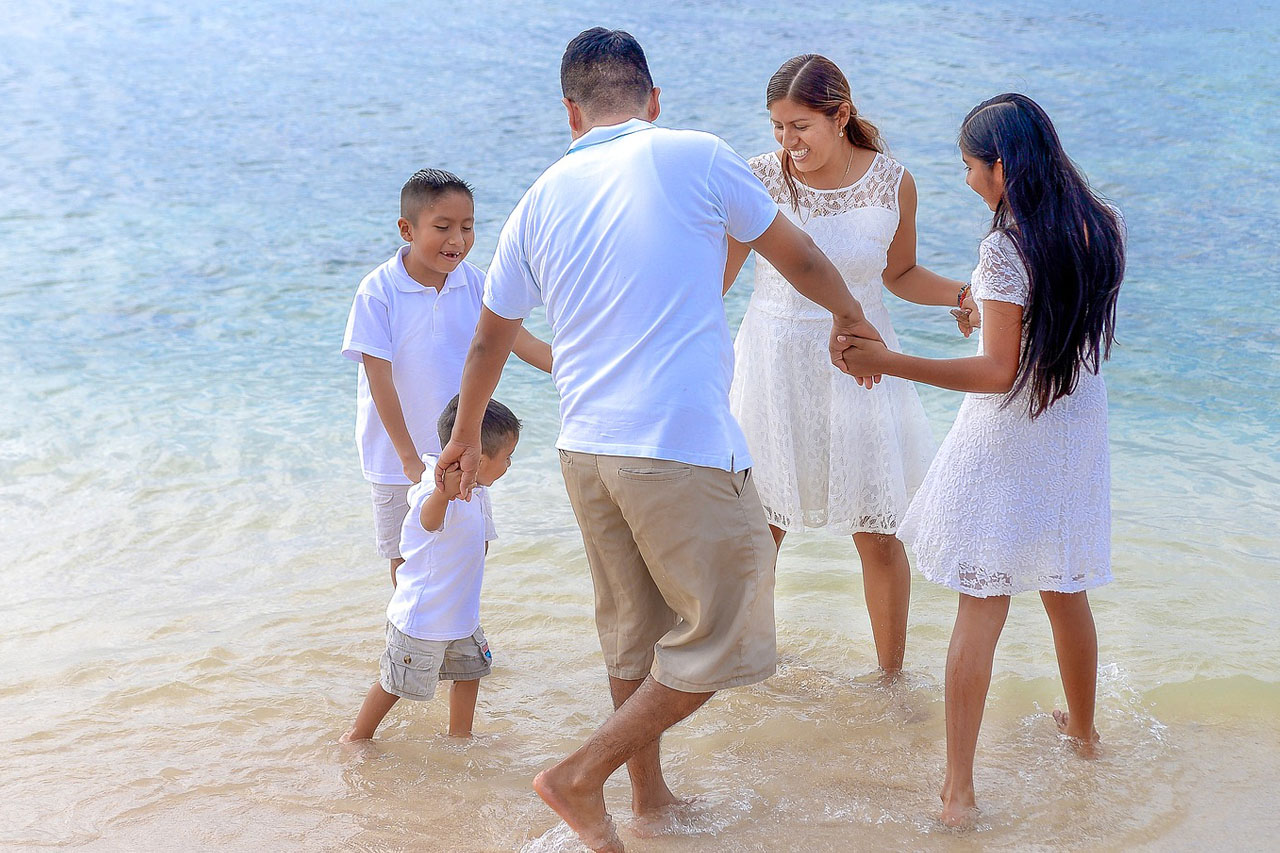 Family Dancing on Beach 1280x853
