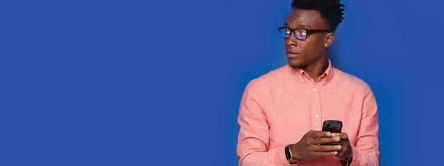 Eye doctor african american man wearing bluetech lenses eyeglasses in Madison, WI