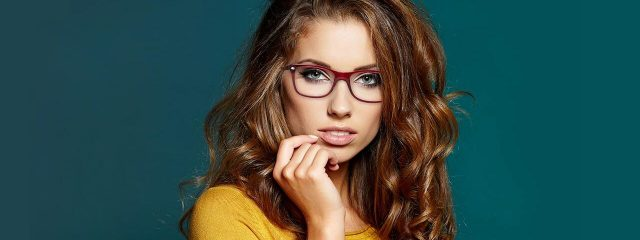 Optometrist, woman wearing designer eyeglasses in in Madison, WI