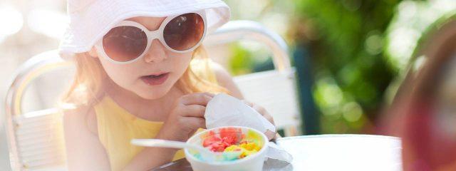 Eye doctor, little girl wearing sunglasses in Waterloo, ON