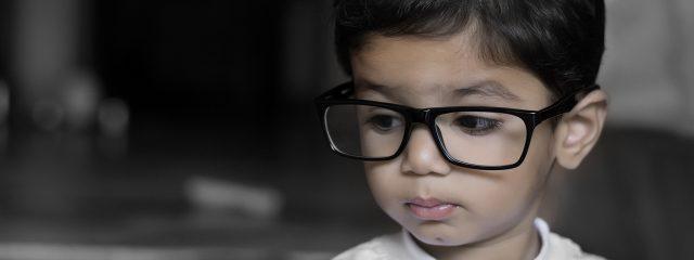 Optometrist, boy wearing eyeglasses