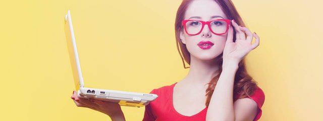 Optometrist, woman holding a laptop