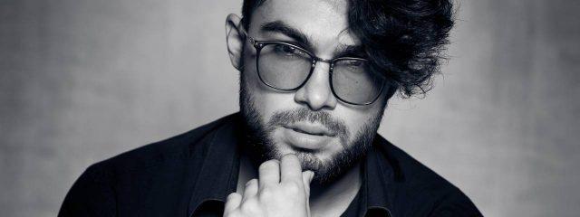 Optometrist, man wearing Transitions lenses eyeglasses