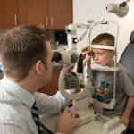 eye doctor, little boy in contact lens eye exam in Waterloo, ON