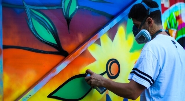 man using paint sprays 640×350