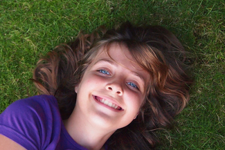 happy girl laying grass thumbnail