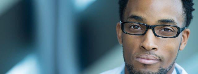 Eye doctor, african american man wearing eyeglasses in Coral Gables, FL