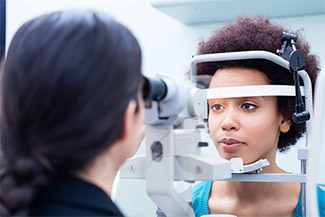 african american woman getting eye exam