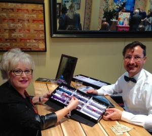 Photo of Denise with Lafont representative looking at Lafont frame selection