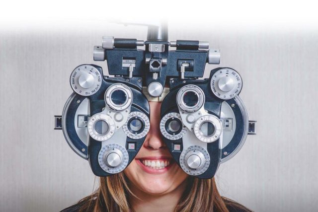 eye care, woman enjoying eye exam in Huntington, Lake Grove, New York