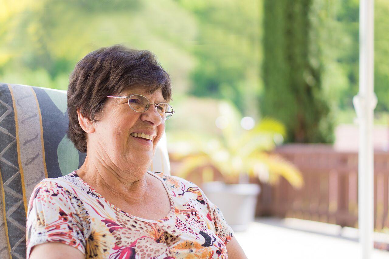 senior woman wearing glasses after CXL for keratoconus
