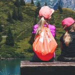 optometrsit, sisters, resting on a hike, wearing contacts in Huntington, Lake Grove, New York