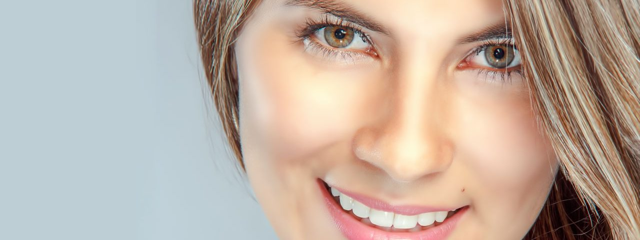 Eye doctor, woman smiling with contact lenses in Huntington Station & Lake Grove, NY