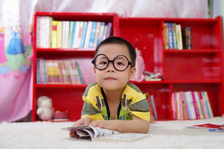 eye doctor, cute little boy wearing eyeglasses for Myopia in Huntington, Lake Grove, New York