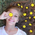 optometrist, girl smiling under myopia management in Huntington, Lake Grove, New York