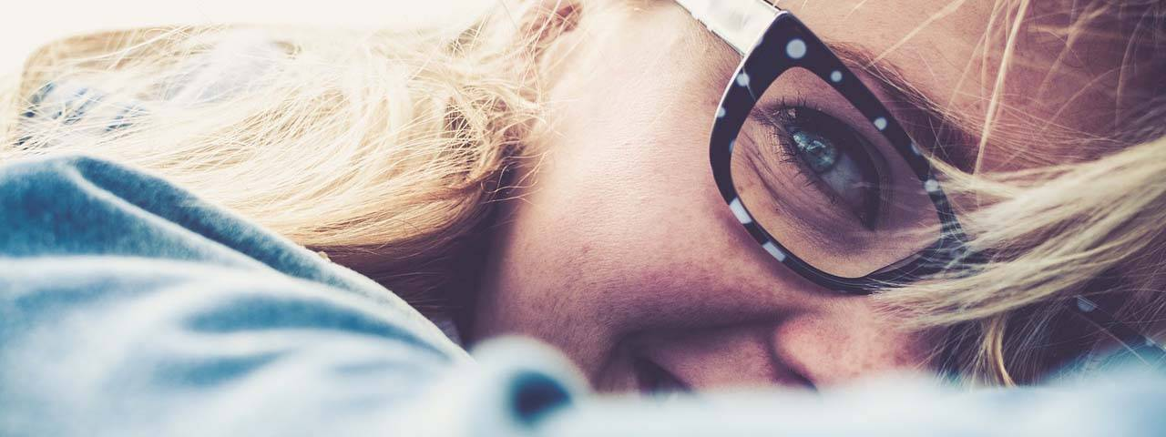 woman wearing glasses after Hot Compress for Dry Eye