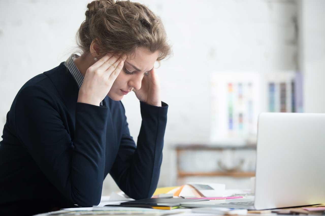 woman with headache and neck pain, digital strain in Costa Mesa, CA