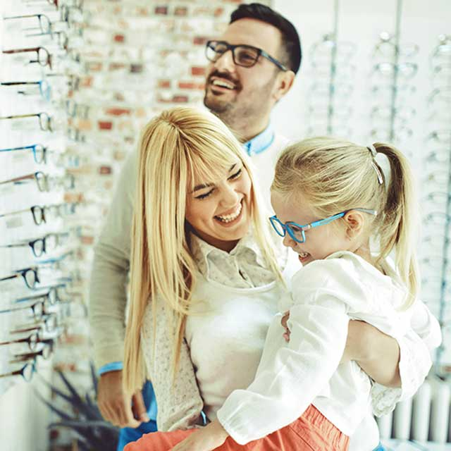 Family wearing eyeglasses and smiling