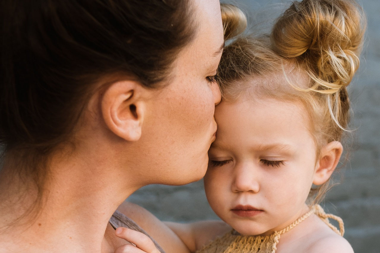 Mother Kissing Female Child 1280x853