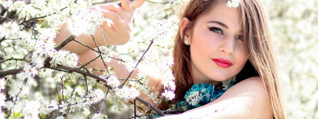 Eye doctor, woman among cherry blossoms in Mentor, Painesville, Highland Heights & Chagrin Falls, OH