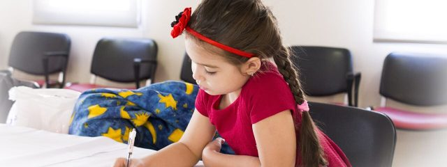 Eye doctor, little girl at school in Mentor, Painesville, Highland Heights & Chagrin Falls, OH