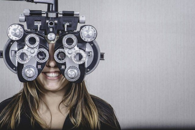 Woman at an eye exam in Mento, Painesville, Highland Heights, Chagrin Falls, OH