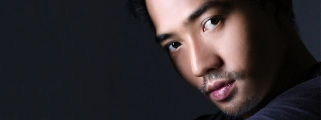 asian man with contact lenses