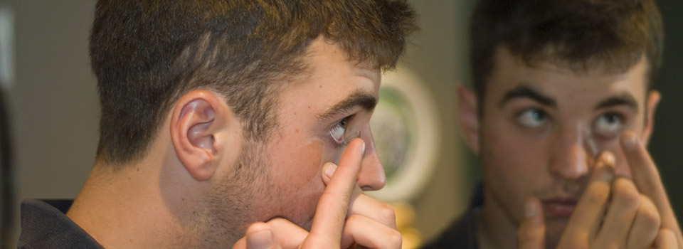 Optometrist, man putting contact lens in San Jose, CA