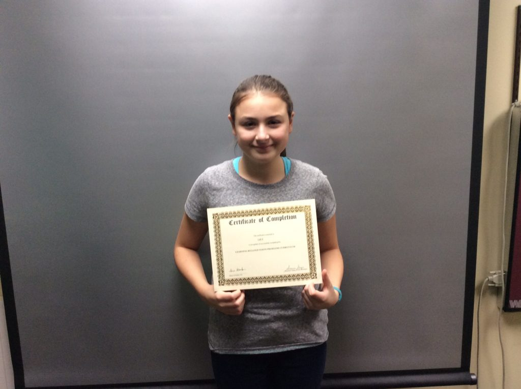 Lily's mom and dad are so proud that she graduated vision therapy