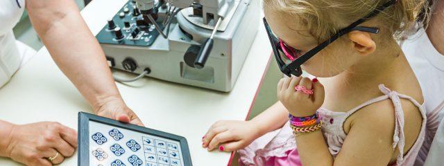 Optometrist, little girl at an eye exam in Winnipeg, Manitoba