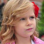 Eye doctor, little girl thinking in Winnipeg, Manitoba