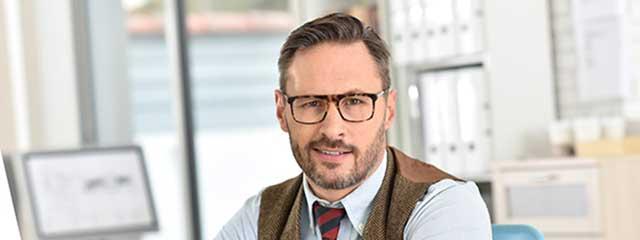 eye exam, man wearing hoya computer lenses in Bolton, ON