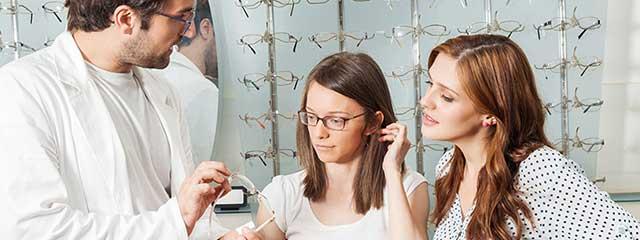 optometrist, womans selecting hoya lenses in Bolton, ON