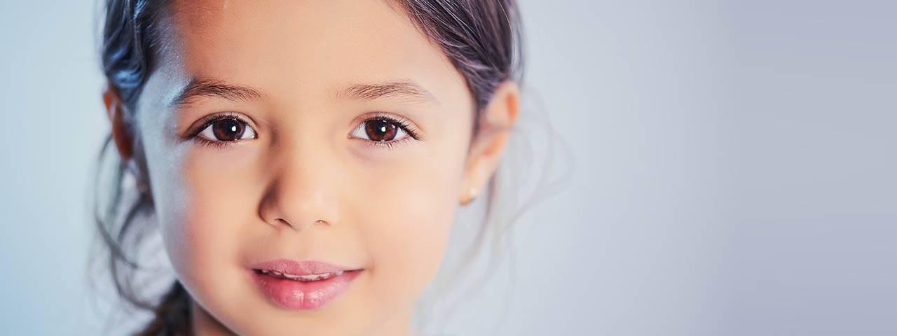 child sparkle brown eyes