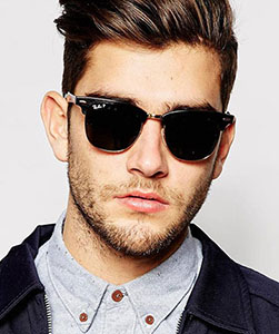 Model wearing RayBan sunglasses