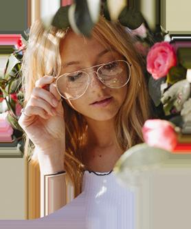 Woman in garden, wearing eyeglasses in Laconia, NH