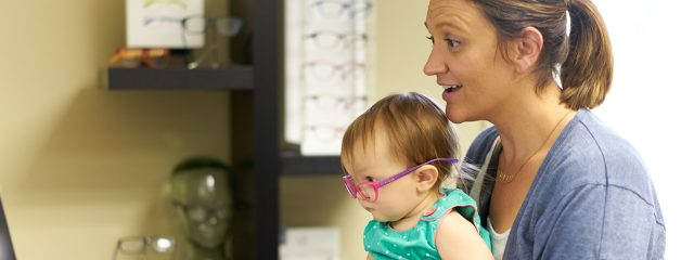 Eye doctor,  mother with her baby in Oak Brook, IL