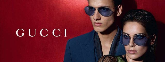 Optometrist, man & woman wearing Gucci sunglasses in Oak Brook, IL