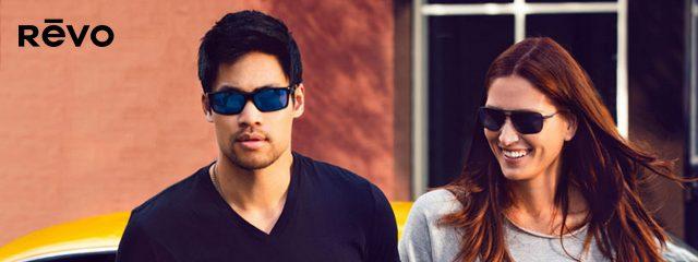 Eye doctor, man and woman wearing Revo Sunglasses in Oak Brook, IL