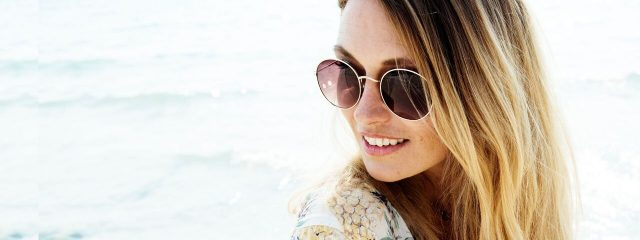 Optometrist, woman wearing Rag and Bone sunglasses in Oak Brook, IL